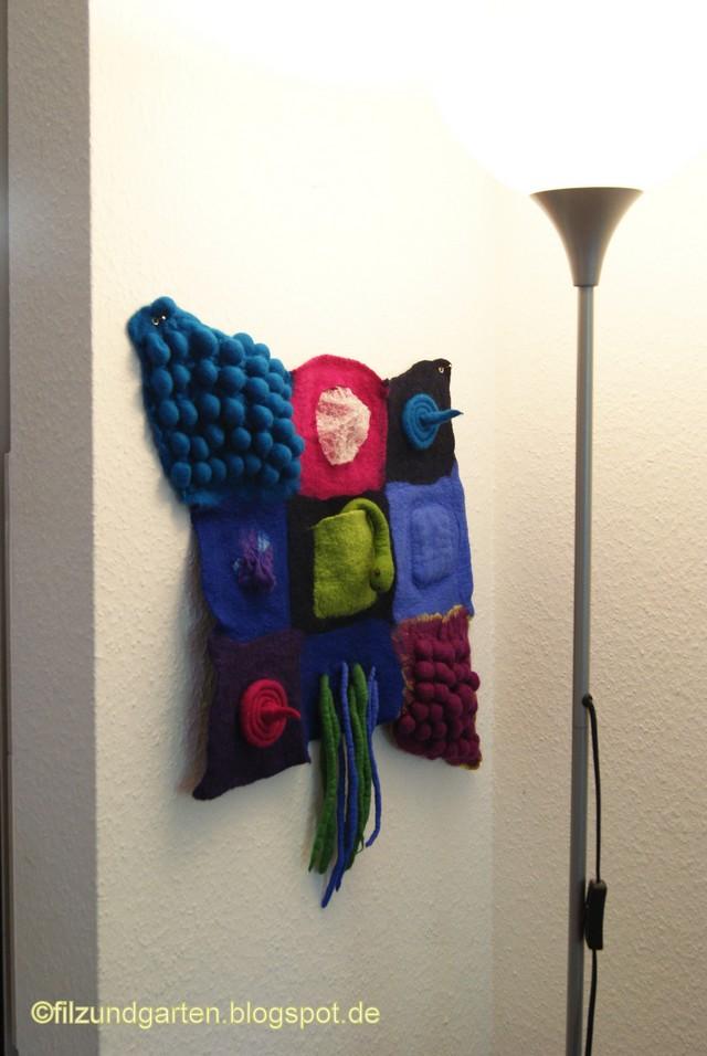 Filzobjekt zum Tasten als Wandbehang