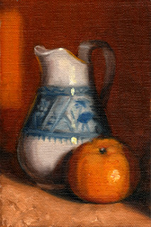 Oil painting of a white porcelain jug with blue designs beside a mandarine.