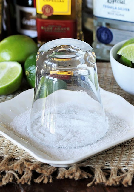 Dipping Margarita Glass Rim in Salt Image