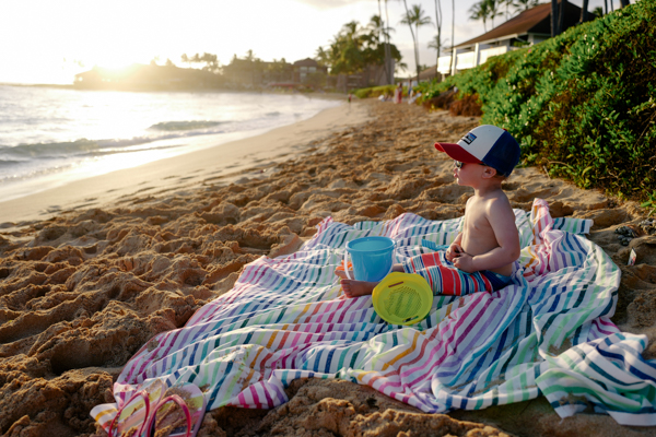 Perfect beach set-up: sand toys, shades & a colorful striped Las Bayadas blanket