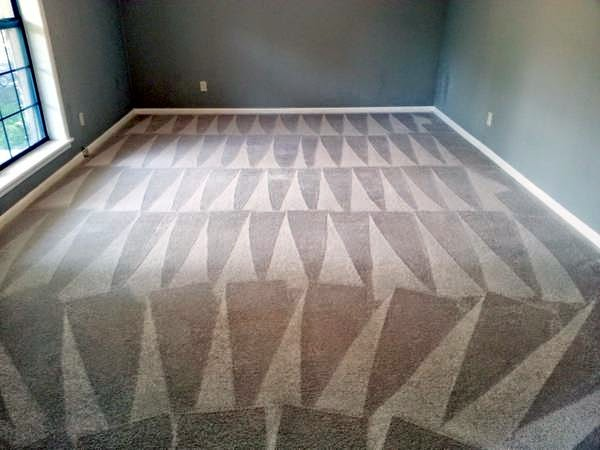 A cleaned dining room carpet part of the $99 carpet cleaning special