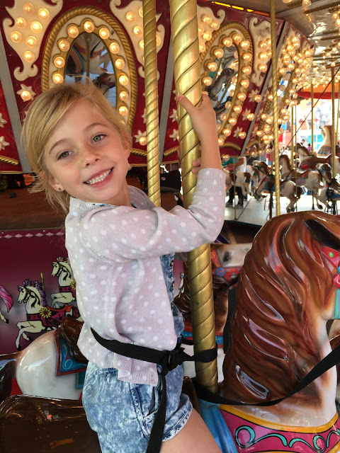 Little girl on Merry Go Round at the Carnival at the Houston Rodeo