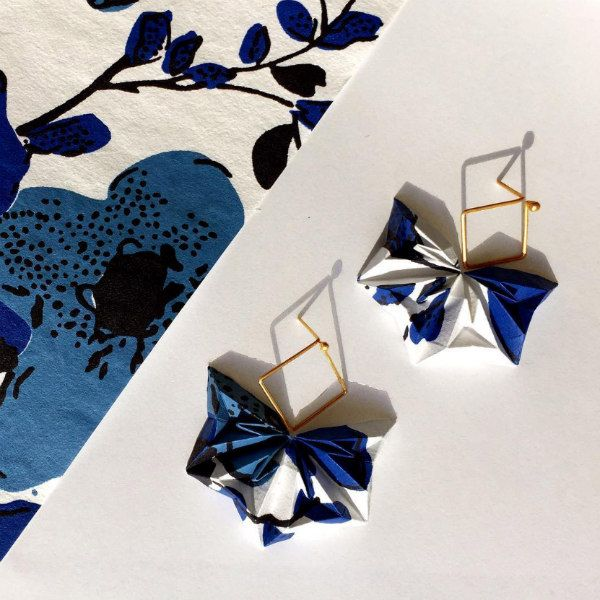 origami fan-shaped paper earrings in blue and white