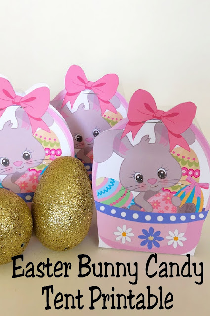I love these candy tents! They are the perfect easy and cute party favor for any Easter party.  Simply print out the cute Easter Bunny candy tent printable and you have a sweet treat to give students, friends, and neighbors this Easter. #easter #easterbasket #easterprintable #diypartymomblog
