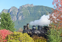 Steam locomotive 924 heads an excursion train departing west from North Bend.