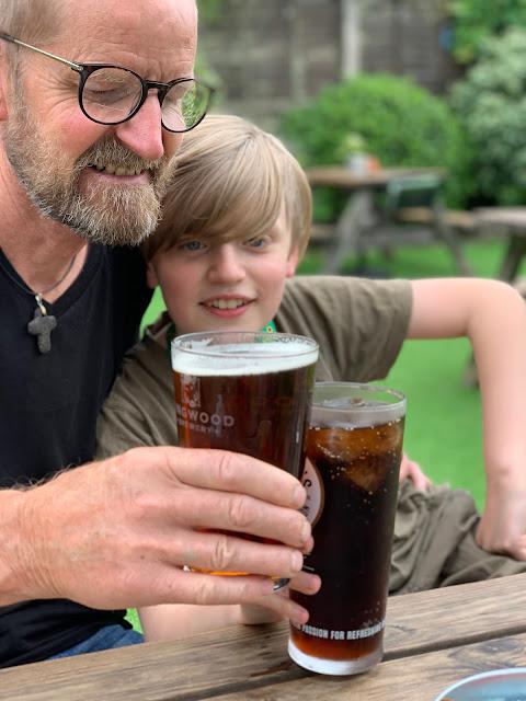 Dad and son in pub garden