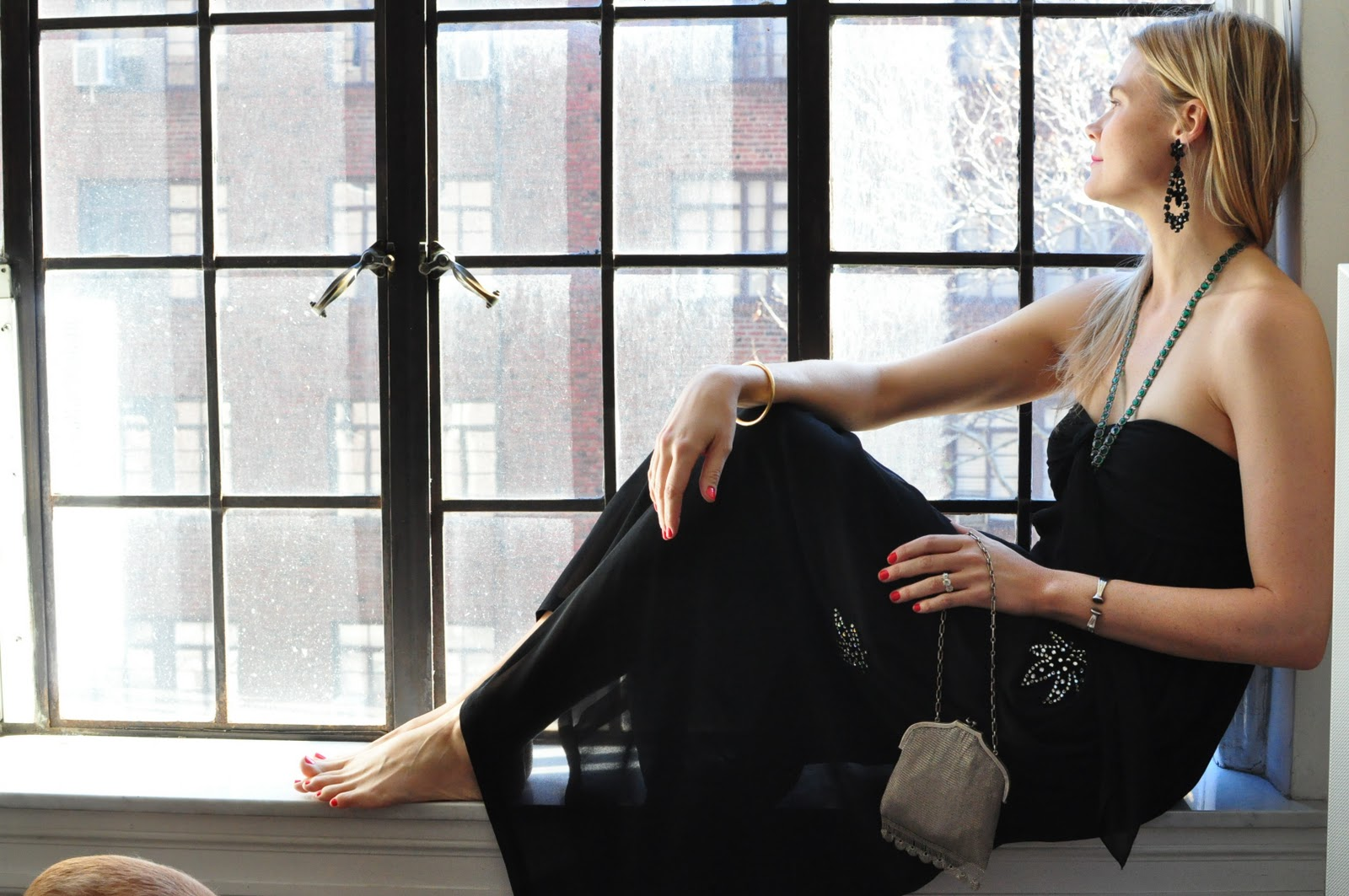 Kate Schelter in a New York apartment window sill - photo by Natalie Joos of Tales of Endearment