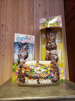 two large chocolate rabbits in their boxes and a party tray of assorted chocolatey confections sit atop a counter at Palmer's Candy in Sioux City