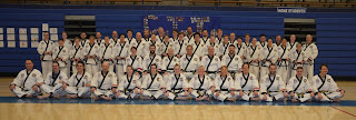 Black belts developing leadership through martial arts lessons