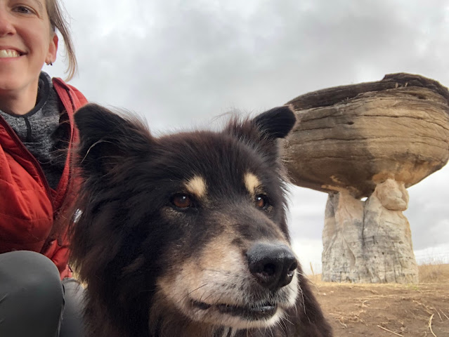 woman, dog, and strange rock formation
