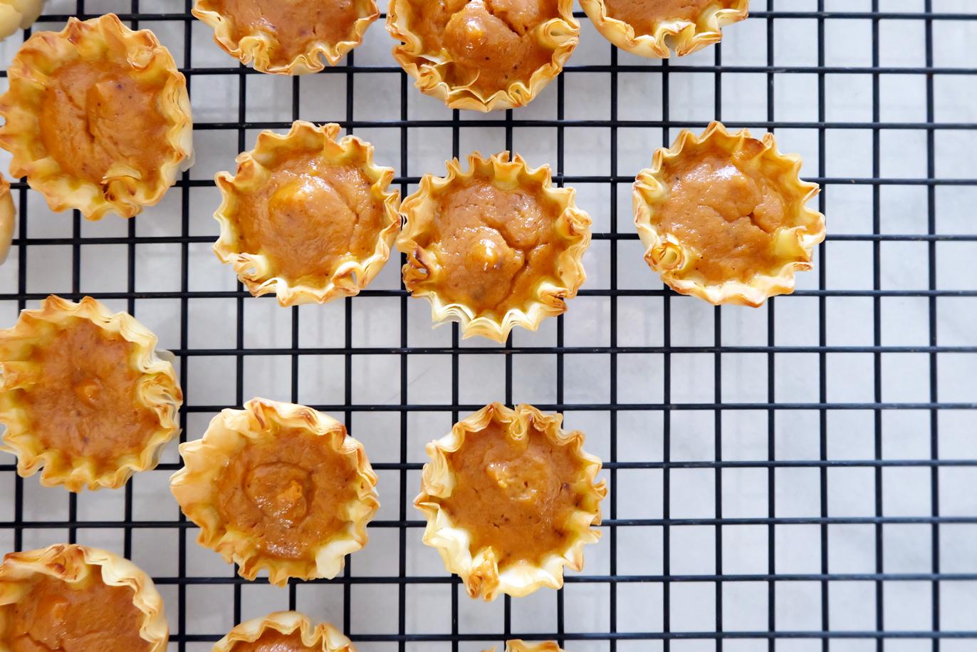 mini pumpkin pies on cooling rack