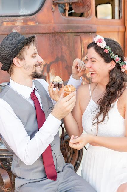 cupcake sharing between bride and groom at micro wedding