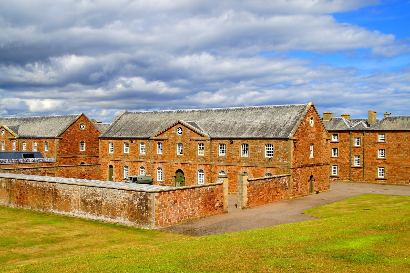 an old prison consisting of several large brick buildings covers a wide area to illustrate a blog post about the movie the last castle