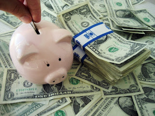 saving money piggy bank and dollars