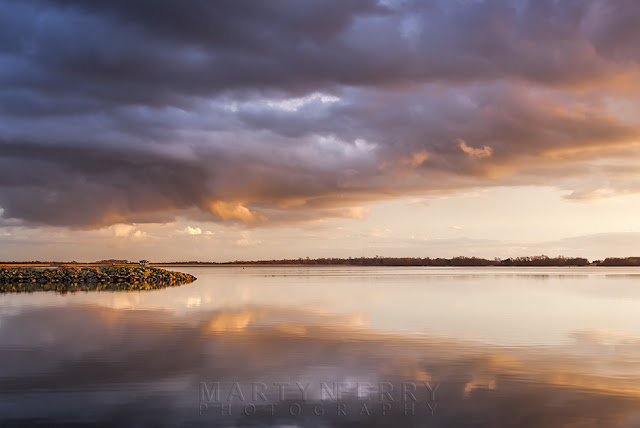 Cambridgeshire reservoir at Grafham Water under sunset skies