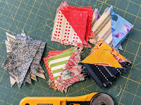 Waster triangles from the original squares used to make the hatchet blocks as sewn into smaller HST blocks