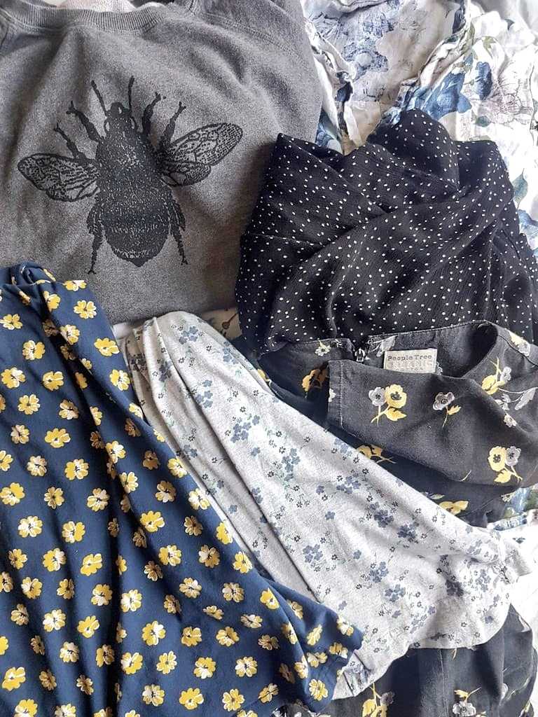 Sustainable Fashion secondhand haul from a charity shop and apps with floral print dresses and grey bee design jumper