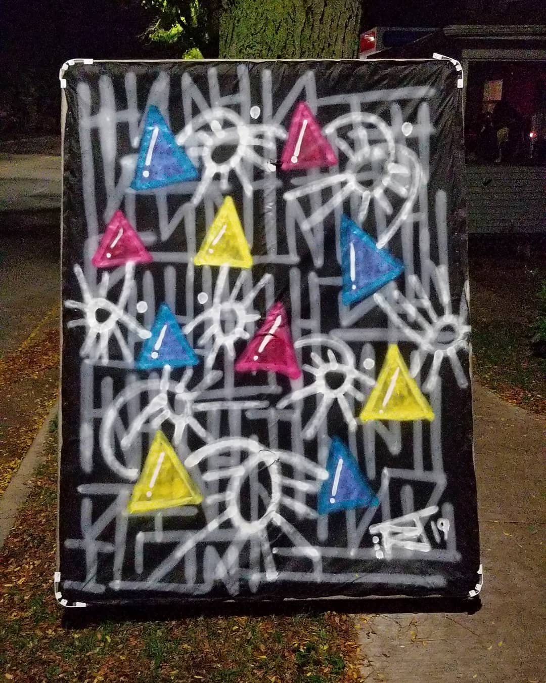 Image contains street art outdoors on box spring