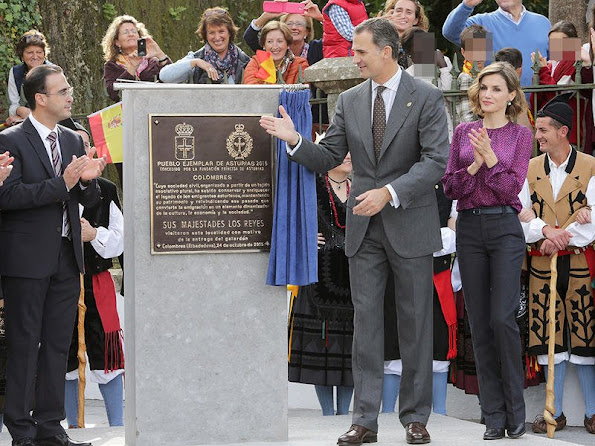 King Felipe and Queen Letizia visit Colombres, Asturias, Spain Queen Letizia wore Hugo Boss Trouser - pant, wore carolina herrera blouse, tous earrings, mango coat