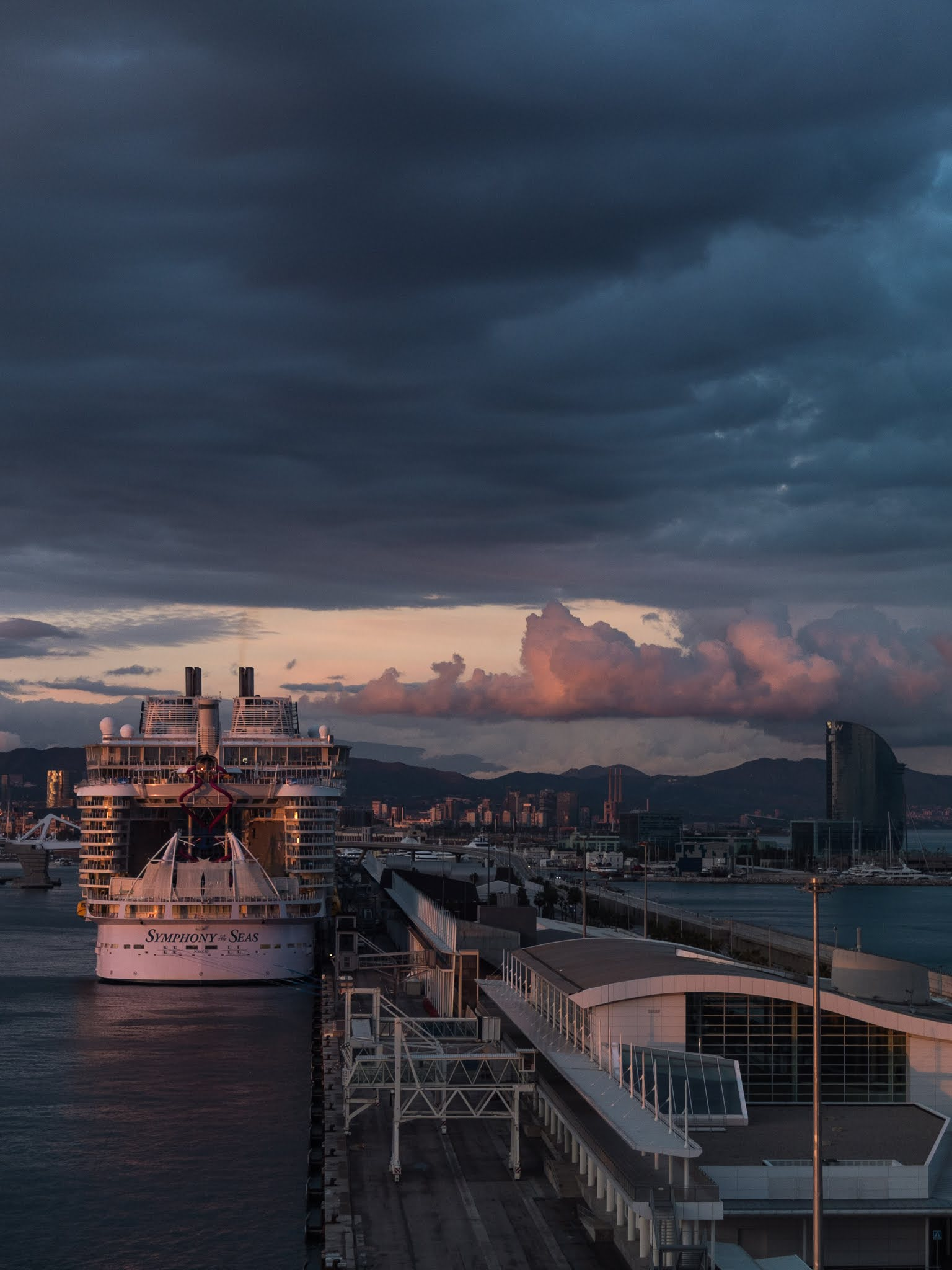The Symphony of the Seas docked in Barcelona captured at sunset in October 2018.