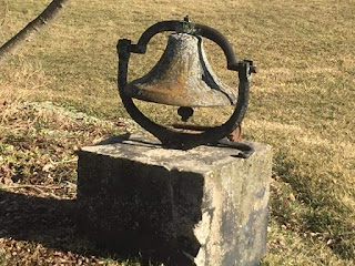 Image Omemee Ontario Farm Bell On Concrete Block