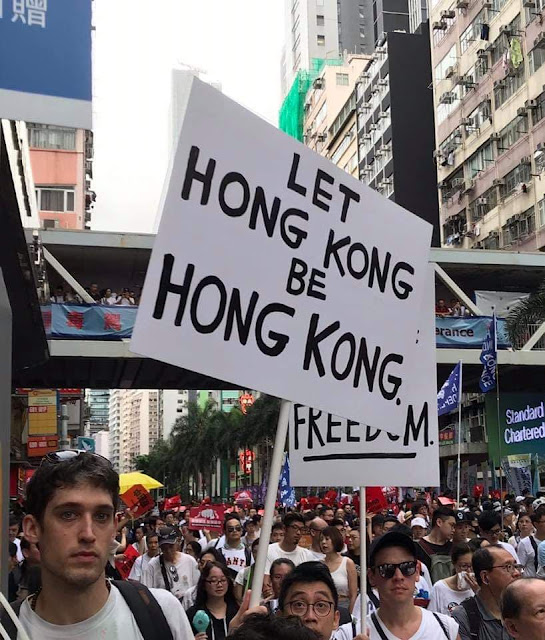 """let Hong Kong be Hong Kong"" sign"