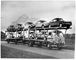 Bond cars on delivery truck