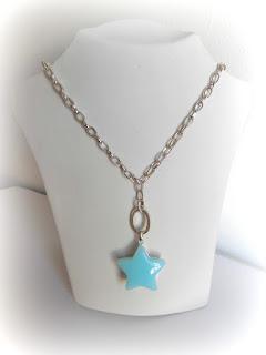 estrella plateada y azul