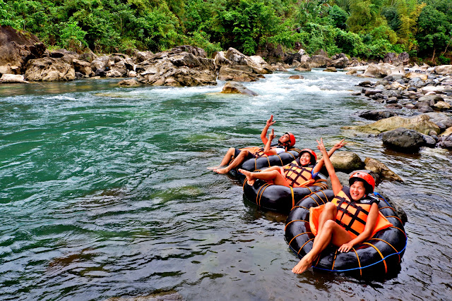 Three travel bloggers enjoying the river tubing in Tibiao, Antique