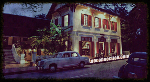 Vintage photo of Luangprabang with old street cars