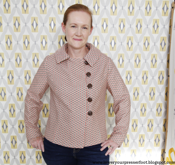 a white woman posing in a jacket