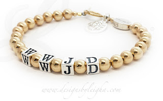 DBL-WWJD-9Gold This Gold WWJD Bracelet is beautiful, elegant and simple with a 14k gold-filled toggle clasp. They added 2 things to their Gold WWJD Bracelet order: IN MEMORY Message Bead and a Tree of Life Charm.
