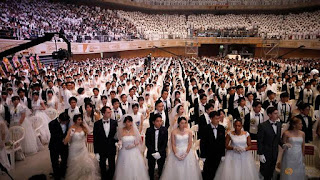 Couples attend a mass wedding ceremony of the Unification Church at Cheongshim Peace World Centre in Gapyeong, South Korea, August 27, 2018. REUTERS/Kim Hong-Ji Read more at https://www.channelnewsasia.com/news/asia/new-generations-sustain-south-korean-church-s-mass-weddings-10657820