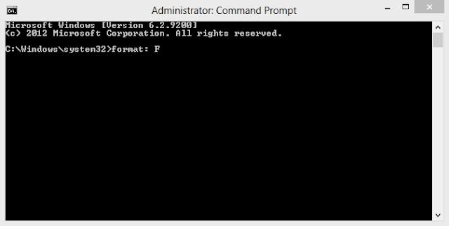 """Pada Command Prompt, ketik """"format: F"""" (sesuai lokasi drive) pada Windows"""