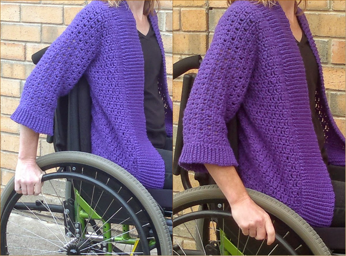 Side view of Jodie wearing cardigan in wheelchair with close-up of sleeves in a 'wheeling' posture to demonstrate that the sleeves do not get caught up in the wheels.