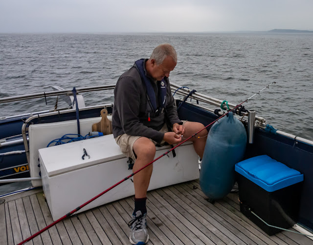 Photo of Phil setting up one of his fishing rods on Ravensdale's aft deck