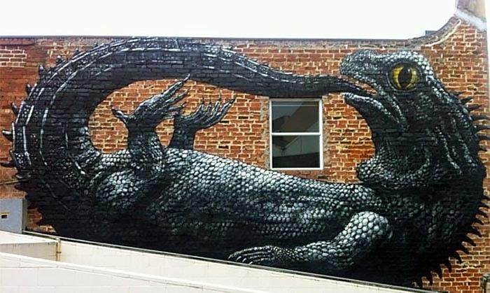 New Street Art mural by Belgian artist ROA in the city of Dunedin in New Zealand. 1