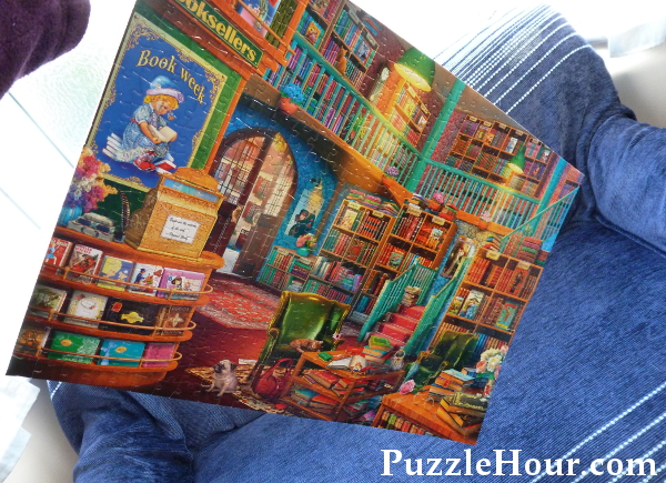 Buffalo Games Jigsaw Puzzle Corner Bookstore Complete holding in the air due to tight fit fitting pieces
