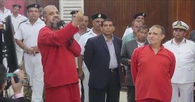 شاهد أول ظهور للبلتاجى ببدلة السجن الحمراء بعد حكم إعدامه بقضية رابعة