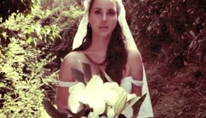White dress, veil and bouquet: Lana Del Rey video for the song Ultraviolence
