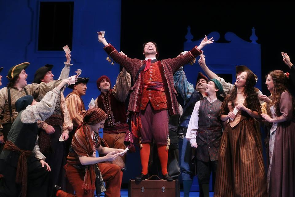 IN PERFORMANCE: Baritone TROY COOK as Figaro (center) in North Carolina Opera's production of Gioachino Rossini's IL BARBIERE DI SIVIGLIA, 1 April 2016 [Photo by Curtis Brown, © by North Carolina Opera]