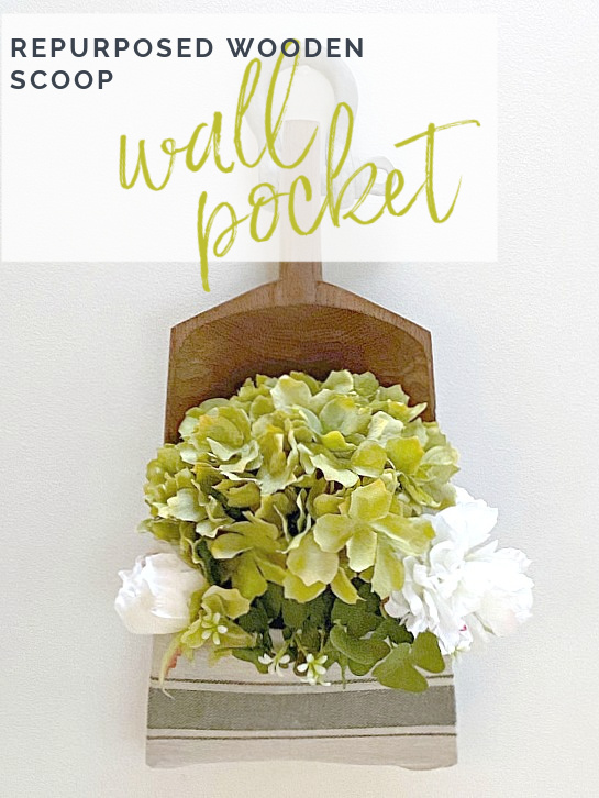 wall pocket full of flowers with overlay
