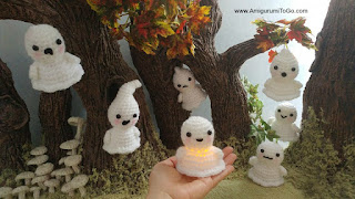 crochet ghosts in the woods.