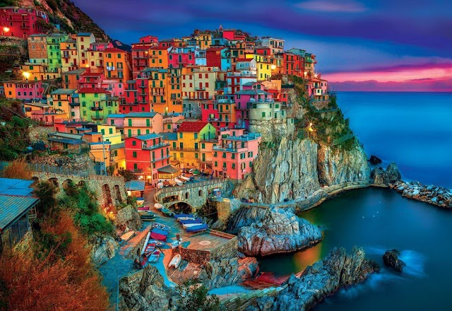 Lost in the middle of beautiful rainbow houses like fairy tales in Italy