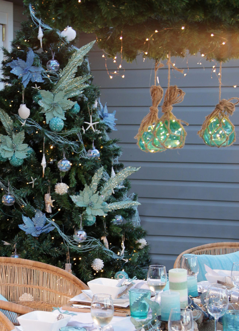 Glass Float Christmas Light above Table Coastal Porch Dining Idea
