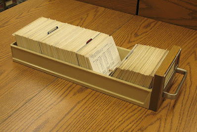 A drawer from a card file, full of cards