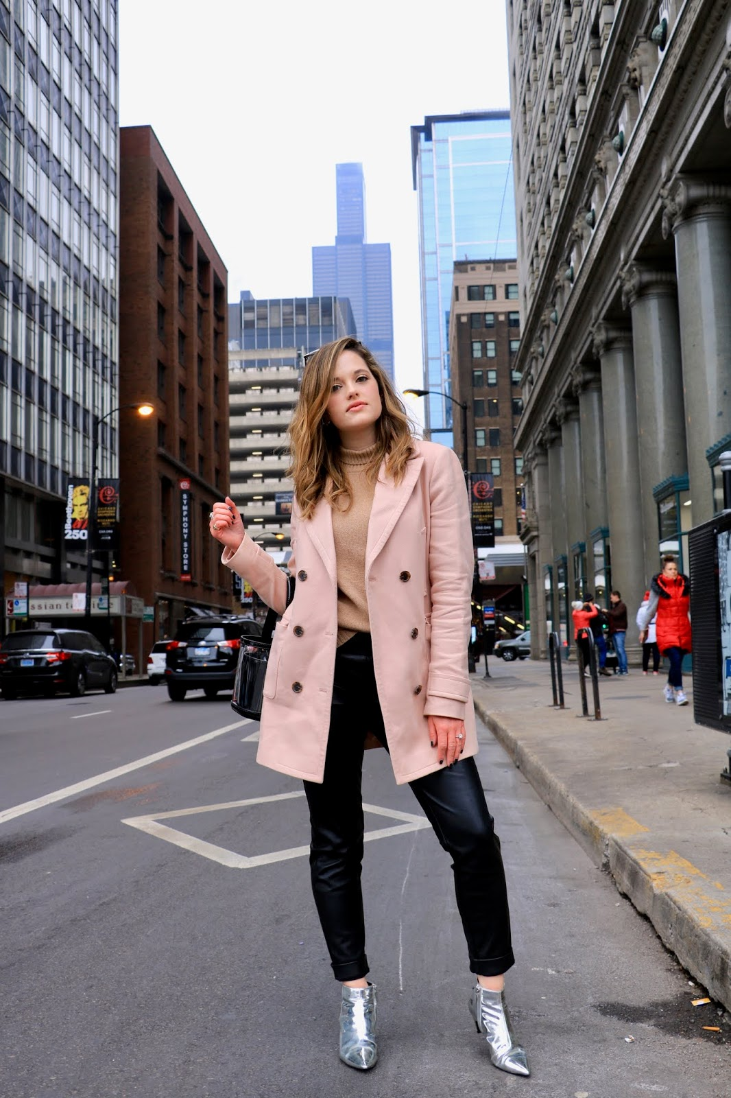 Chicago fashion blogger Kathleen Harper wearing an outfit with metallic silver boots.