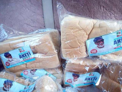 Loaves of bread with photos of APC governorship candidate in Ondo State, Rotimi Akeredolu seen on the streets (photo)
