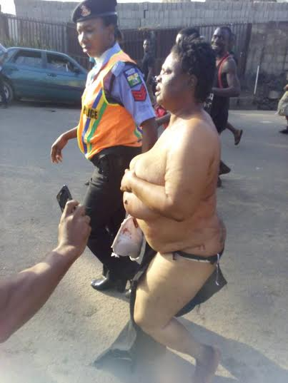 Suspected Female Kidnapper Apprehended In Lagos, Stripped Almost Naked (Photos)