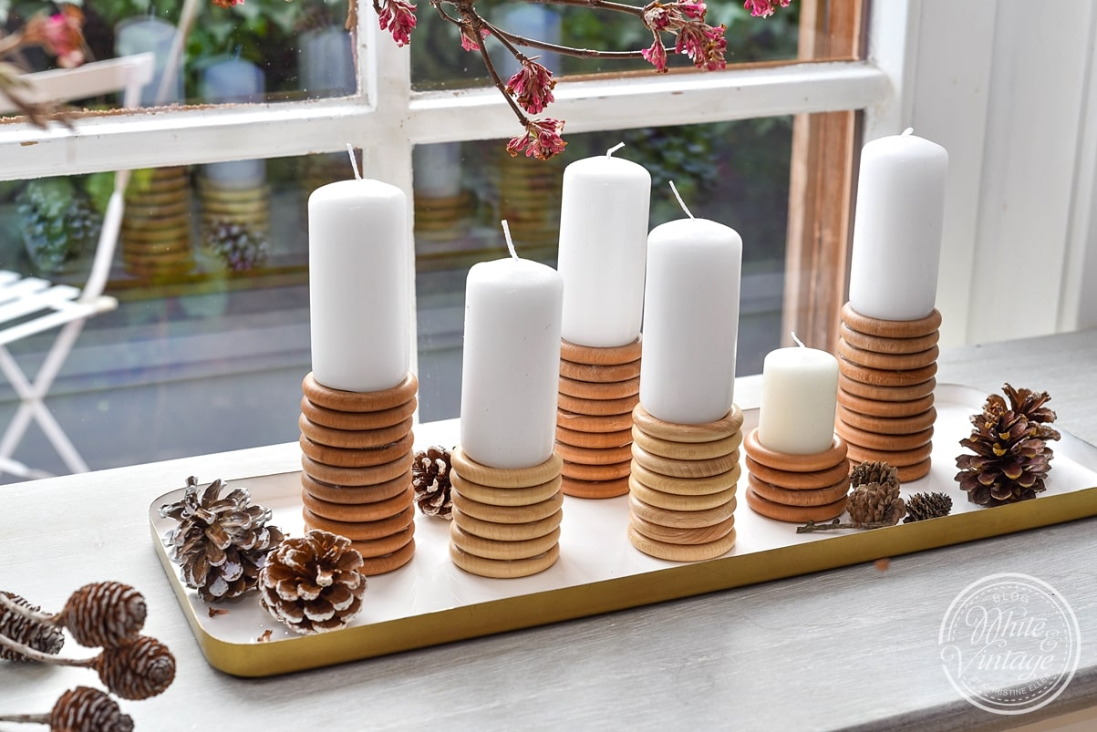 Kerzenständer aus Holzringen basteln.